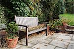 Garden bench on a traditional flagstone patio in autumn / fall Stock Photo - Royalty-Free, Artist: paulmaguire                   , Code: 400-05373165