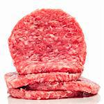 a pile of raw burgers on a white background Stock Photo - Royalty-Free, Artist: nito                          , Code: 400-05373330