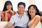 Family Sitting Together At Home Stock Photo - Royalty-Free, Artist: MonkeyBusinessImages          , Code: 400-05374700