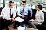 Portrait of three partners discussing new working plan at meeting Stock Photo - Royalty-Free, Artist: pressmaster                   , Code: 400-05376647