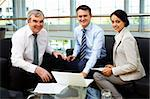 Portrait of happy team looking at camera at workplace Stock Photo - Royalty-Free, Artist: pressmaster                   , Code: 400-05376648
