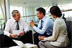 Portrait of busy people discussing new strategies and ideas at meeting Stock Photo - Royalty-Free, Artist: pressmaster                   , Code: 400-05376649
