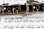 Fragment of black shining clarinet over opened music book Stock Photo - Royalty-Free, Artist: simply                        , Code: 400-05376790