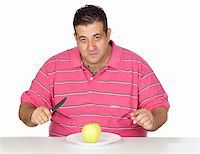 Fat man eating a apple isolated on white background Stock Photo - Royalty-Freenull, Code: 400-05376851