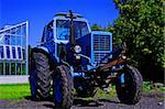 Painted in blue tractor standing before glass building Stock Photo - Royalty-Free, Artist: vetdoctor                     , Code: 400-05380145