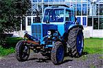Painted in blue tractor standing before glass building Stock Photo - Royalty-Free, Artist: vetdoctor                     , Code: 400-05380146