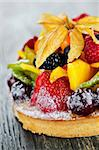 Fresh dessert fruit tart covered in assorted tropical fruits Stock Photo - Royalty-Free, Artist: Elenathewise                  , Code: 400-05380257