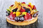 Fresh dessert fruit tart covered in assorted tropical fruits Stock Photo - Royalty-Free, Artist: Elenathewise                  , Code: 400-05380258