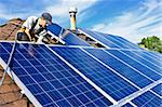 Man installing alternative energy photovoltaic solar panels on roof Stock Photo - Royalty-Free, Artist: Elenathewise                  , Code: 400-05380323