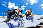 Workers installing alternative energy photovoltaic solar panels on roof Stock Photo - Royalty-Free, Artist: Elenathewise                  , Code: 400-05380327