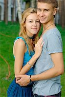 rosspetukhov - Close-up portrait of a happy teenage couple at the park Stock Photo - Royalty-Freenull, Code: 400-05381227