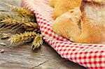 Freshly baked bread variety on wooden background Stock Photo - Royalty-Free, Artist: mythja                        , Code: 400-05382407