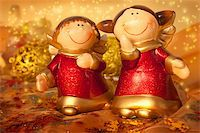 Two Christmas angels on golden setting Stock Photo - Royalty-Freenull, Code: 400-05382594