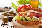 Prosciutto and cheese sandwich with olives and lettuce. Stock Photo - Royalty-Free, Artist: mythja                        , Code: 400-05384761