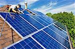 Man installing alternative energy photovoltaic solar panels on roof Stock Photo - Royalty-Free, Artist: Elenathewise                  , Code: 400-05386105