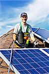 Man installing alternative energy photovoltaic solar panels on roof Stock Photo - Royalty-Free, Artist: Elenathewise                  , Code: 400-05386108