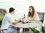 Bride and groom at wedding table near the sea Stock Photo - Royalty-Free, Artist: GoodOlga                      , Code: 400-05386293