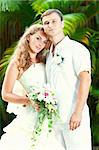 Portrait of bride and groom in a tropical garden. Stock Photo - Royalty-Free, Artist: GoodOlga                      , Code: 400-05386299