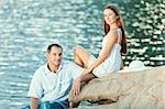 Young couple sitting on the cliff near ocean Stock Photo - Royalty-Free, Artist: GoodOlga                      , Code: 400-05386306