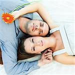 Portrait of young couple lies together outdoor Stock Photo - Royalty-Free, Artist: GoodOlga                      , Code: 400-05386311