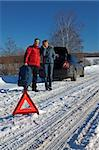 Man And Woman Broken Down On Country Road With Hazard Warning Sign In Foreground Stock Photo - Royalty-Free, Artist: pavelshlykov                  , Code: 400-05387990
