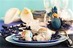 Easter table setting in blue and white tones with candles and flower. Stock Photo - Royalty-Free, Artist: mythja                        , Code: 400-05389017