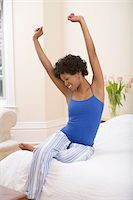 Woman Stretching on Bed Stock Photo - Premium Rights-Managednull, Code: 700-05389238