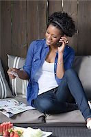 person on phone with credit card - Woman Placing Order Over Telephone Stock Photo - Premium Rights-Managednull, Code: 700-05389241