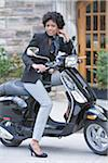 Portrait of Woman on Scooter Stock Photo - Premium Rights-Managed, Artist: Pierre Arsenault, Code: 700-05389247