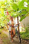 Woman Walking with Bicycle Stock Photo - Premium Rights-Managed, Artist: Ty Milford, Code: 700-05389256