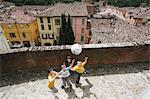 Boys Playing Soccer In Street Stock Photo - Premium Royalty-Freenull, Code: 622-05390959