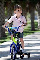 A boy riding a bike Stock Photo - Premium Royalty-Freenull, Code: 653-05393038