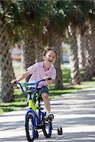 A boy riding a bike Stock Photo - Premium Royalty-Freenull, Code: 653-05393066