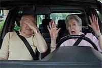 people in panic - Senior woman having trouble learning to drive as man in passenger seat despairs Stock Photo - Premium Royalty-Freenull, Code: 653-05393393