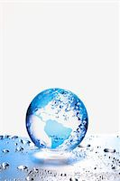 the earth  on metal board Stock Photo - Premium Royalty-Freenull, Code: 6106-05394325