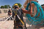 Carpenter unwinding an air hose on the second floor of a house under construction Stock Photo - Premium Royalty-Freenull, Code: 6105-05395977