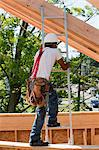 Carpenter climbing a ladder Stock Photo - Premium Royalty-Freenull, Code: 6105-05396025