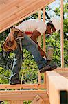 Carpenter working with a nail gun on footer Stock Photo - Premium Royalty-Freenull, Code: 6105-05396085