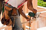 Carpenter cutting bevel with a circular saw Stock Photo - Premium Royalty-Freenull, Code: 6105-05396091