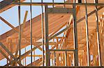 Low angle view of a house framing Stock Photo - Premium Royalty-Freenull, Code: 6105-05396103