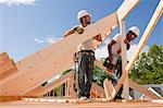 Carpenters aligning roof rafters Stock Photo - Premium Royalty-Free, Artist: Blend Images, Code: 6105-05396106