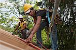 Hispanic carpenters measuring at a house under construction Stock Photo - Premium Royalty-Freenull, Code: 6105-05396145