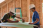 Carpenters measuring exterior sheathing at a construction site Stock Photo - Premium Royalty-Freenull, Code: 6105-05396184