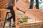 Hispanic carpenters working on upper floor from a beam at a house under construction Stock Photo - Premium Royalty-Freenull, Code: 6105-05396214