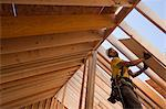 Hispanic carpenter working at a house under construction Stock Photo - Premium Royalty-Freenull, Code: 6105-05396259