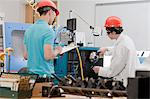 Graduate Assistant and engineering student operating the CNC Machine Stock Photo - Premium Royalty-Freenull, Code: 6105-05396361