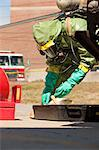 HazMat firefighter preparing decontamination tray Stock Photo - Premium Royalty-Free, Artist: Ikon Images, Code: 6105-05396499