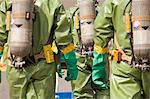 Rear view of HazMat firefighters with air tanks Stock Photo - Premium Royalty-Free, Artist: Ikon Images, Code: 6105-05396517