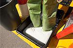 HazMat firefighter standing in decontamination tray Stock Photo - Premium Royalty-Free, Artist: Ikon Images, Code: 6105-05396520