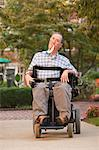 Man with a Duchenne muscular dystrophy sitting in a wheelchair Stock Photo - Premium Royalty-Free, Artist: Minden Pictures, Code: 6105-05396587